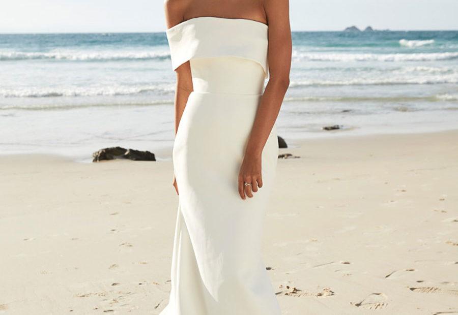 bride on the beach with wedding dress